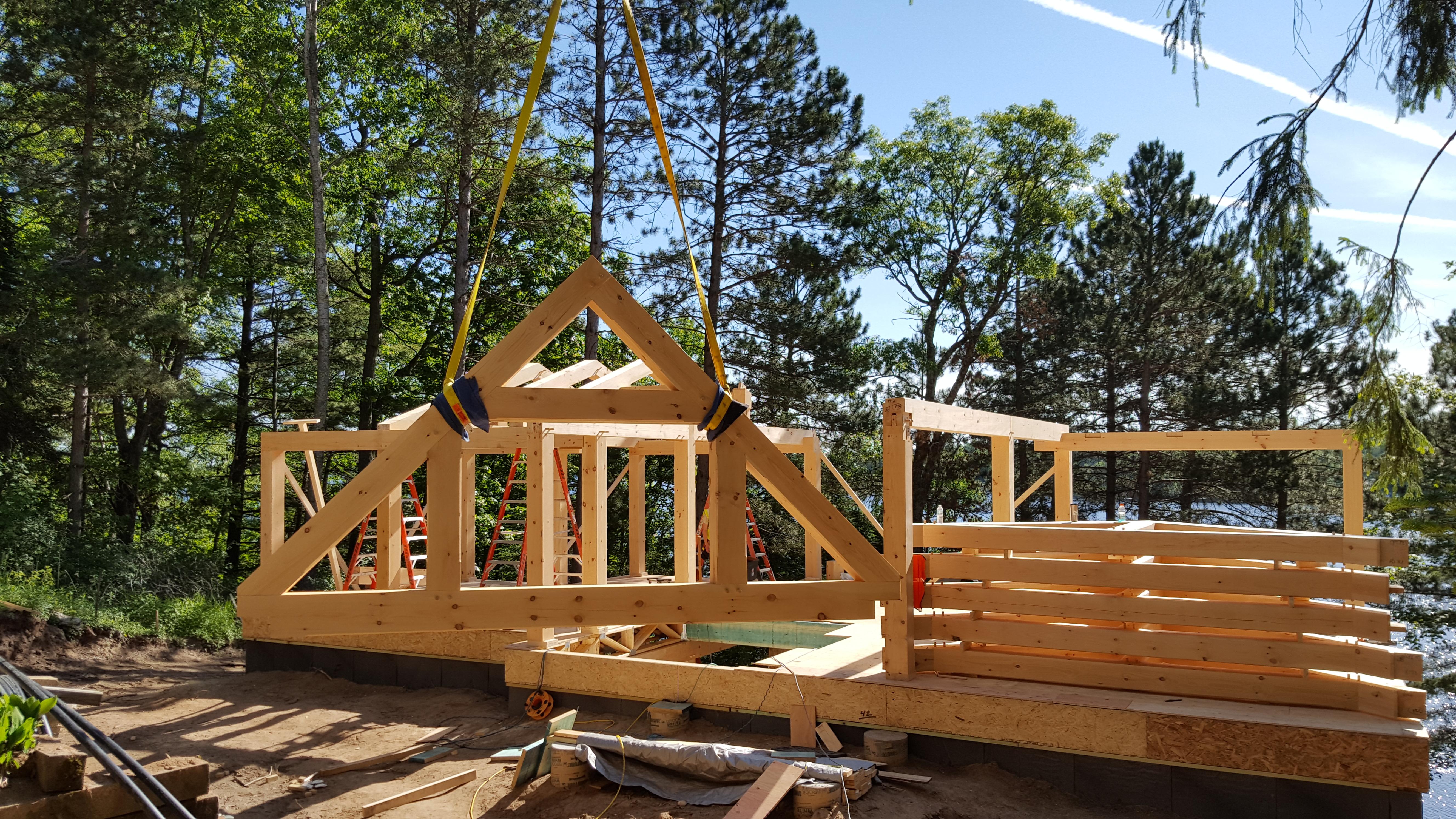 Timber frame raising ewp cabin blue ox timber frames for Timber frame cottage